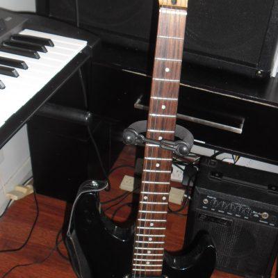 Electric guitar with Rok Axe Amplifier